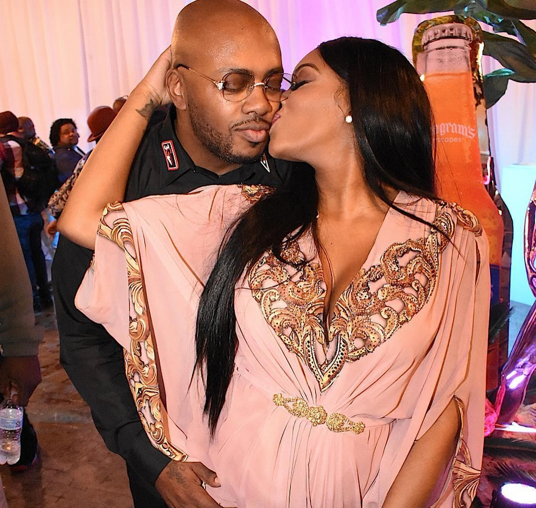 Porsha Williams And Dennis McKinley Pose Next To A Christmas Tree, Proudly Cradling The RHOA Star's Baby Bump