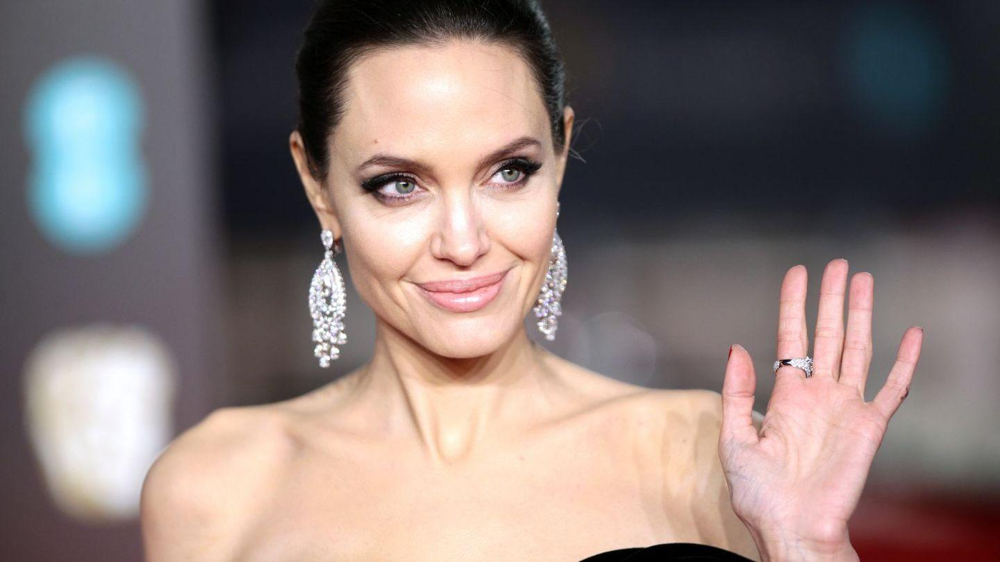 Angelina Jolie - Will She Share A New Year's Eve Kiss With Someone Special?