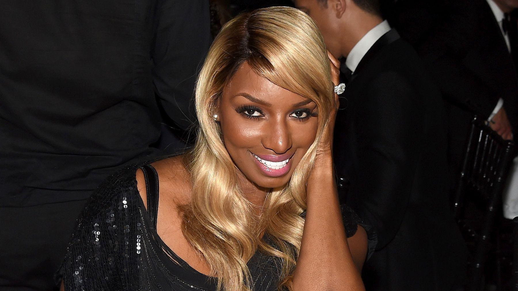 NeNe Leakes Is Radiant In White, Showing Off Her Swagg Boutique