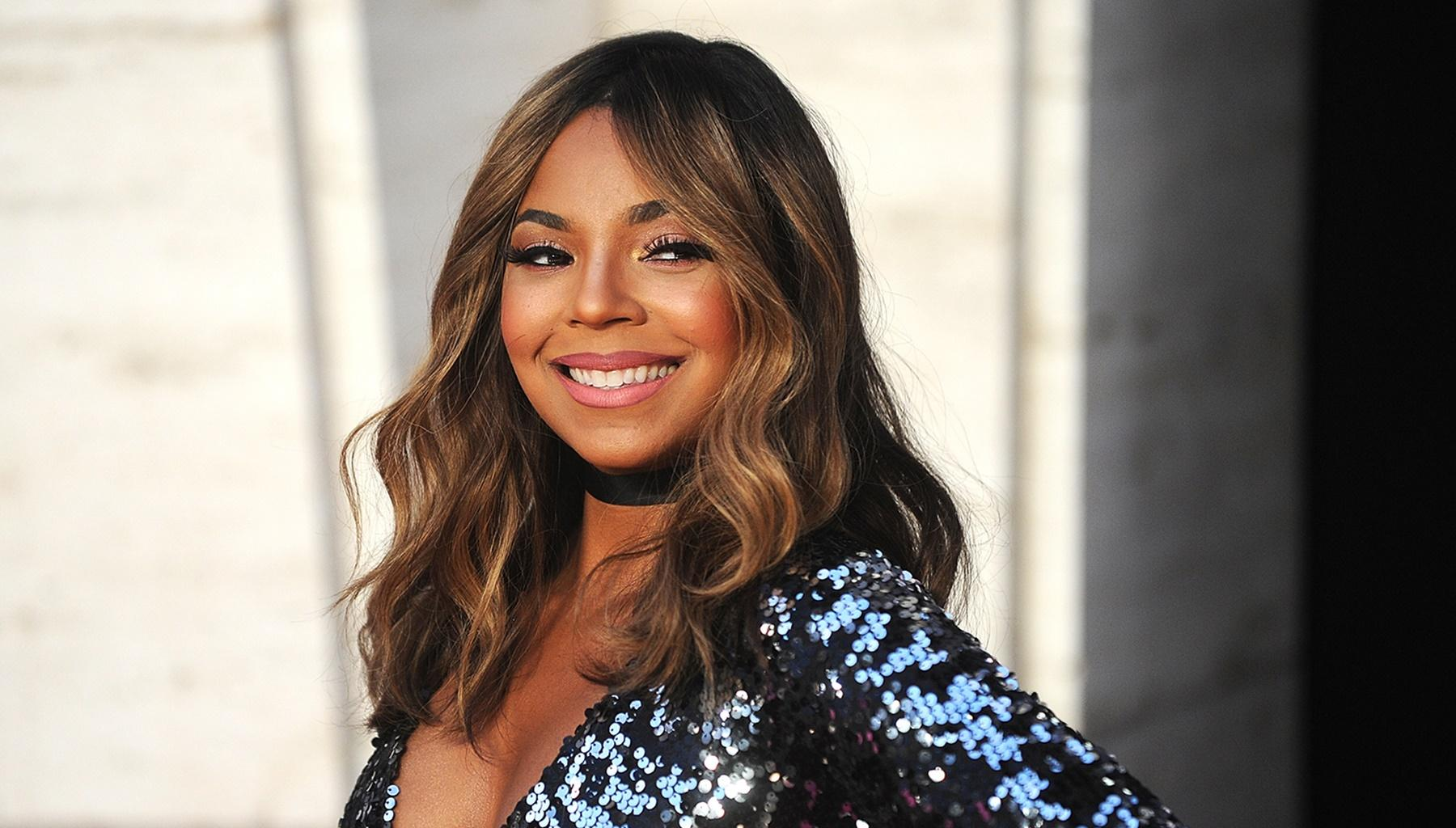 Ashanti Dances In Tiny Bathing Suit Under The Shower While Singing 'Rain On Me' In Viral Video