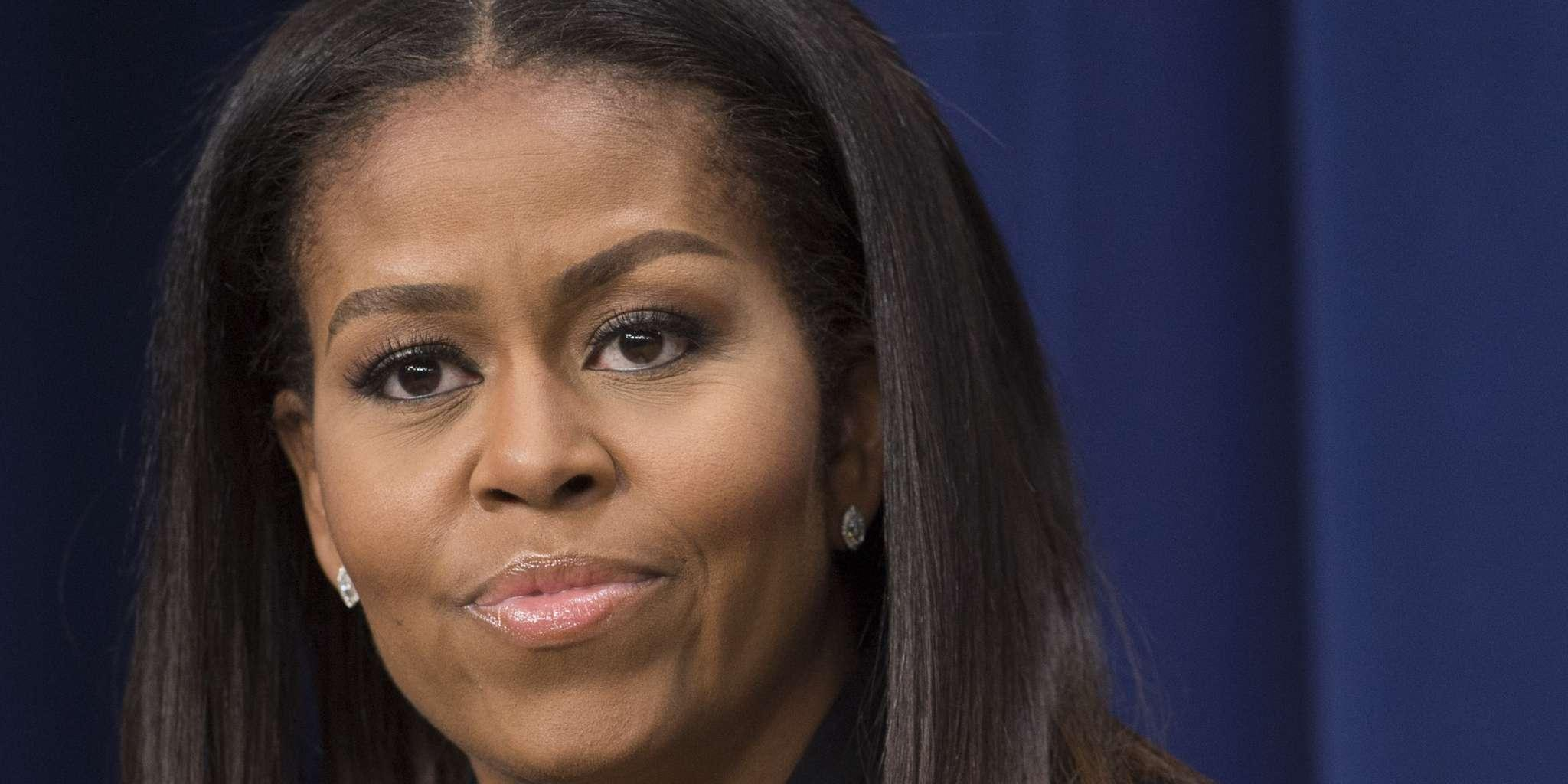 Michelle Obama Shows Off Her Impressive Abs In Cropped T-Shirt On National Signing Day
