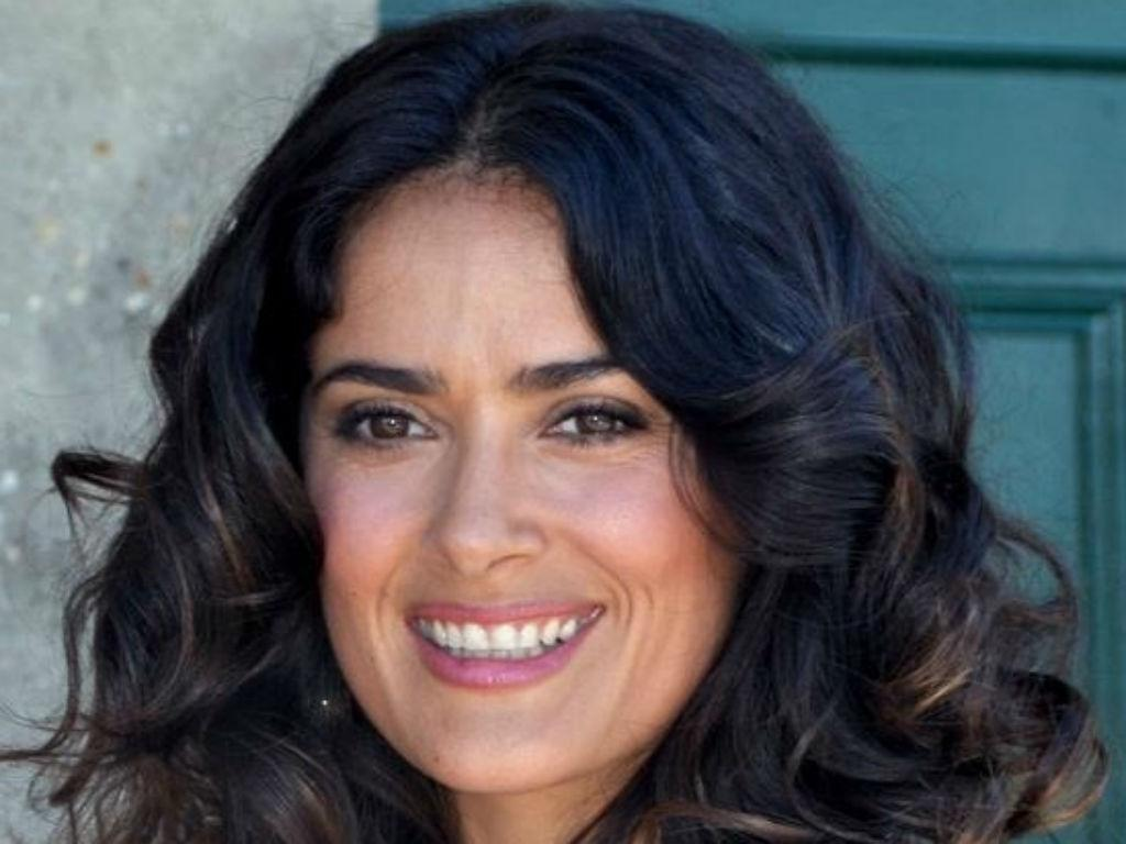 Salma Hayek Posts Stunning Photo In Red Swimsuit With Plunging Neckline On Instagram Driving Fans Wild
