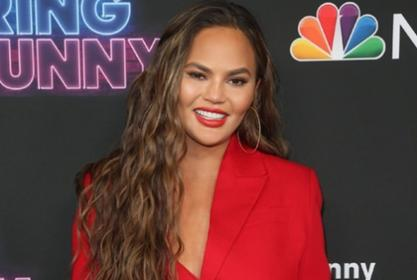 Chrissy Teigen Wows In Red At Bring The Funny Premiere — Check Out Her New Show