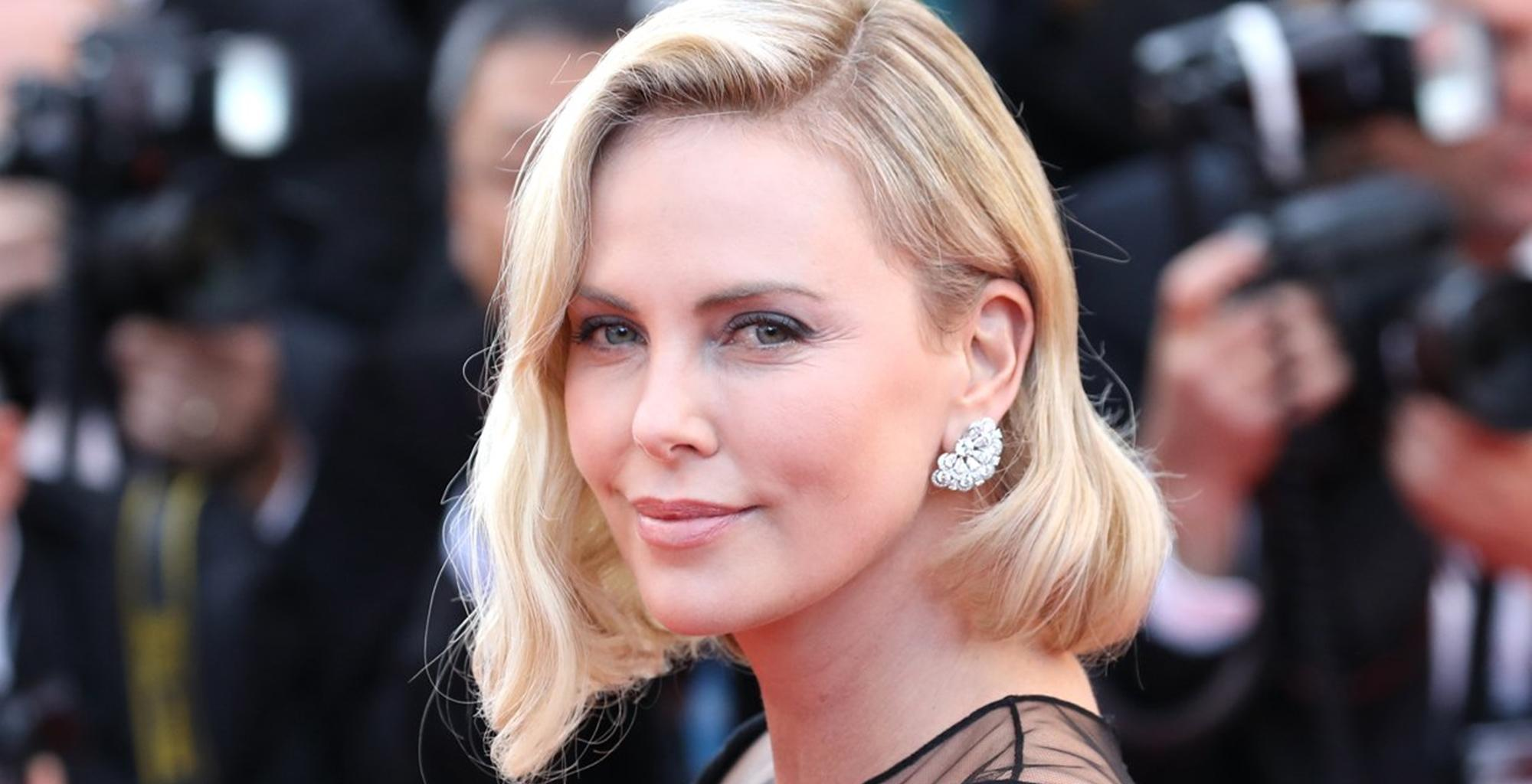 Charlize Theron Posts Photo Of Daughter Jackson In Red Dress During Vacation -- The Reactions Took An Unexpected Turn