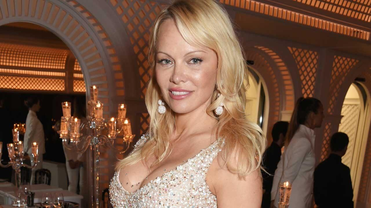 Pamela Anderson Reveals She Still Puts On Her Iconic Red 'Baywatch' Swimsuit For Her Lovers