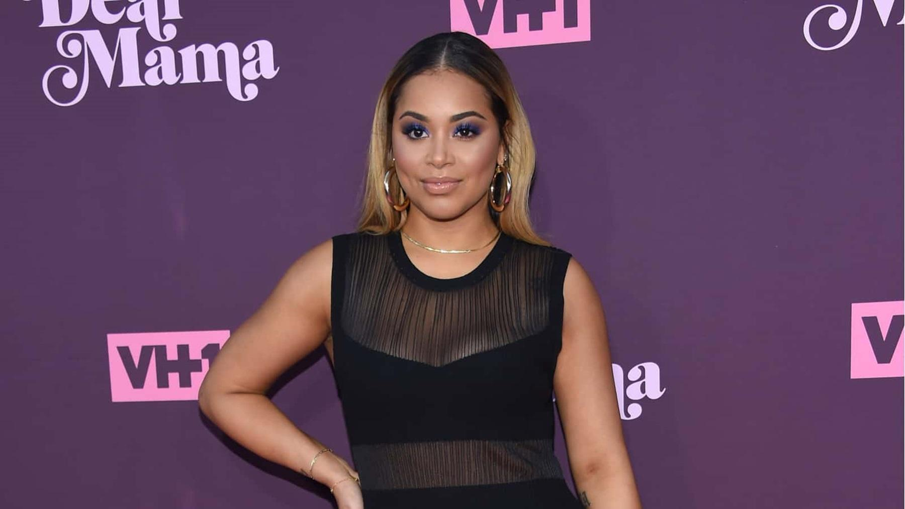 Lauren London Shares Never-Before-Seen Photo Where Nipsey Hussle Is Securing His Queen -- Rain Or Shine He Was A Great Man