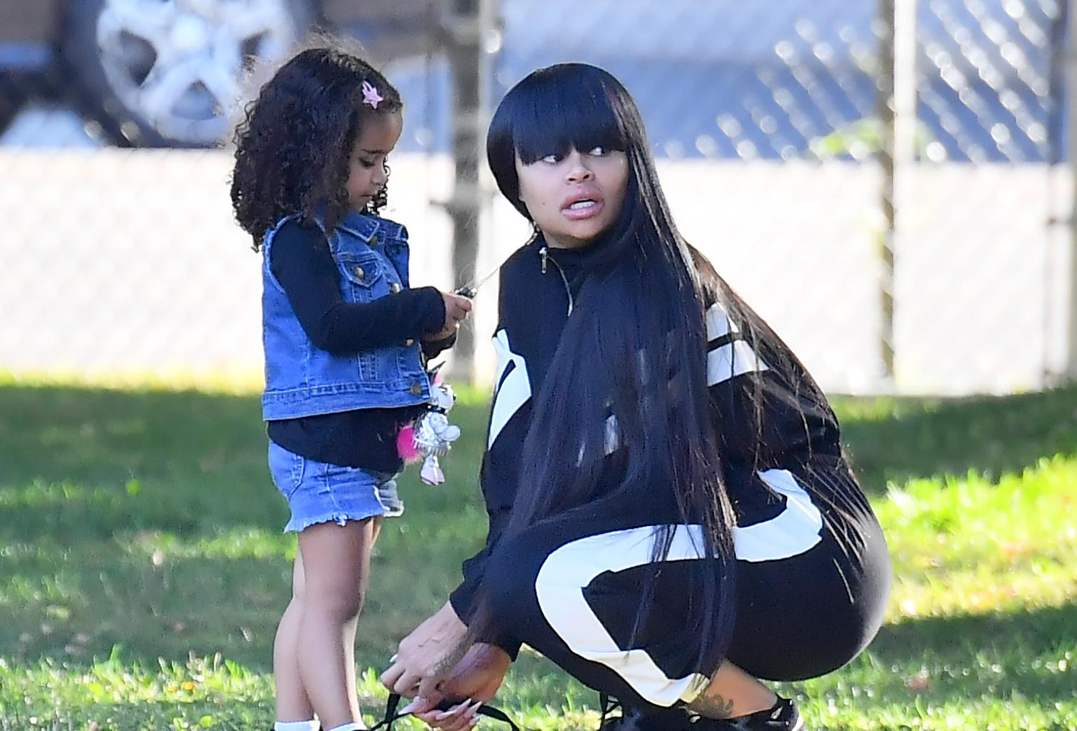 Blac Chyna And Dream Kardashian Look Like Twins With Matching Curly Ponytails As They Smooch In Cute Pic