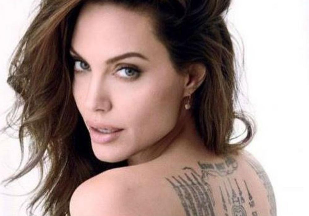 Angelina Jolie Poses Nude For Magazine Cover And Reveals Brad Pitt Has Kept Her From Moving Overseas