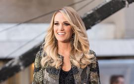 Carrie Underwood Poses In Photos With A Shotgun Accompanied By Husband Mike Fisher -- Fans On Social Media React