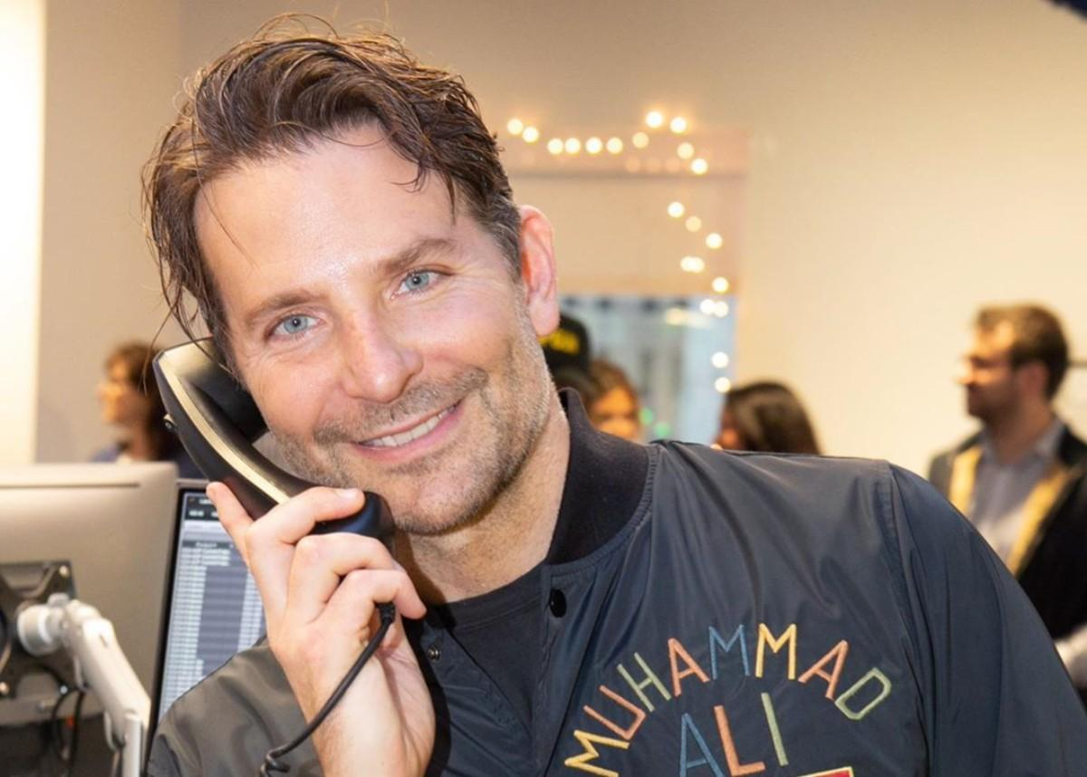 Bradley Cooper Answers Telephones At ICAP Charity Day