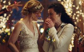 Hallmark Under Fire For Pulling LGBTQ Zola Commerical That Shows Two Lesbian Brides Kissing — Boycott Under Way