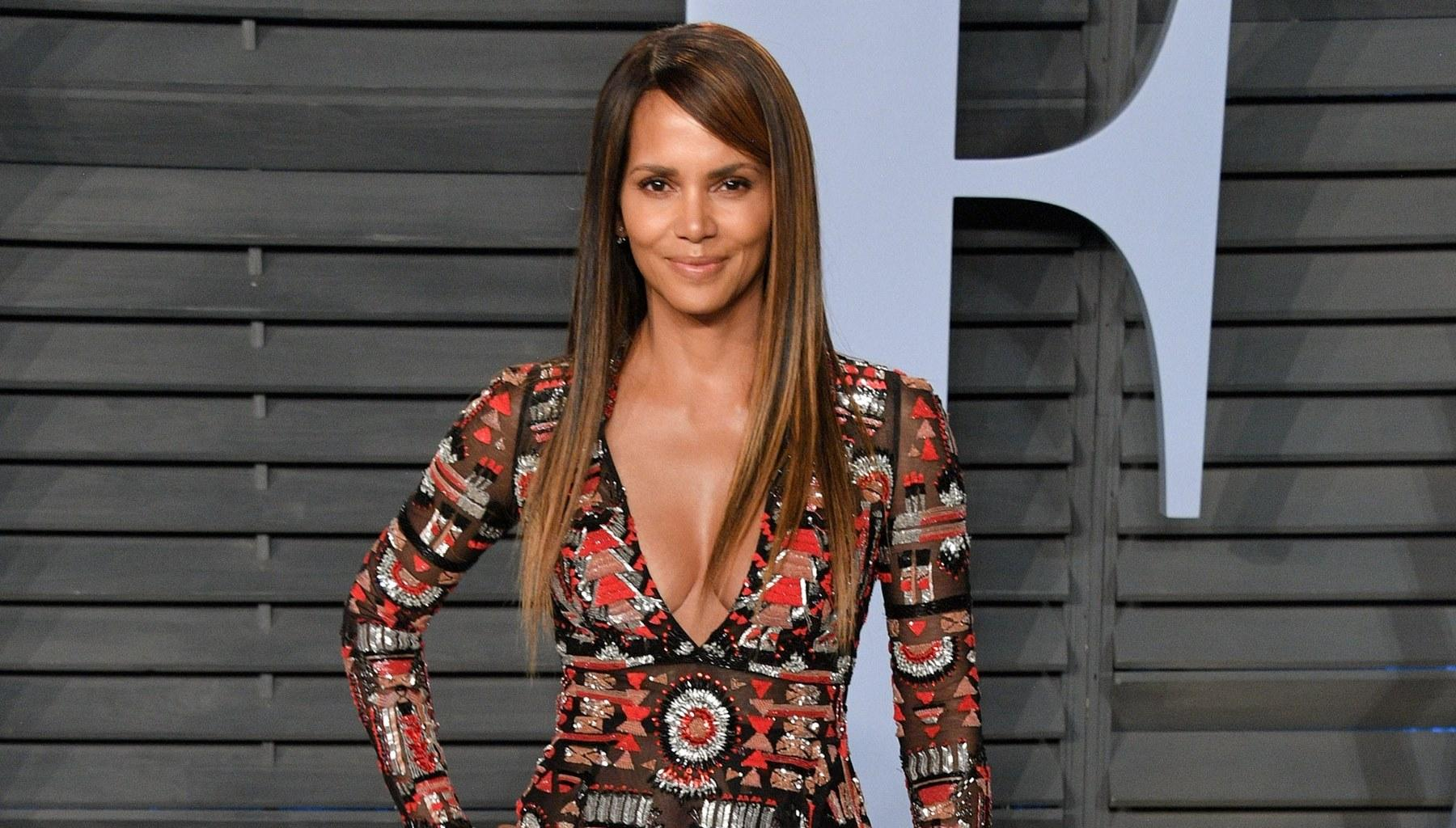 Halle Berry Shows Off Her Stunning Figure In Sheer Top And No Pants In Garden Photo That Has Fans Salivating
