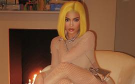 Kylie Jenner Wears Another Banana-Yellow Wig And Pairs It With A Flesh-Colored Fishnet Catsuit