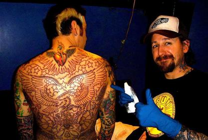 Images Of Tattoo Artist Oliver Peck Wearing Blackface Re-Surface On Social Media