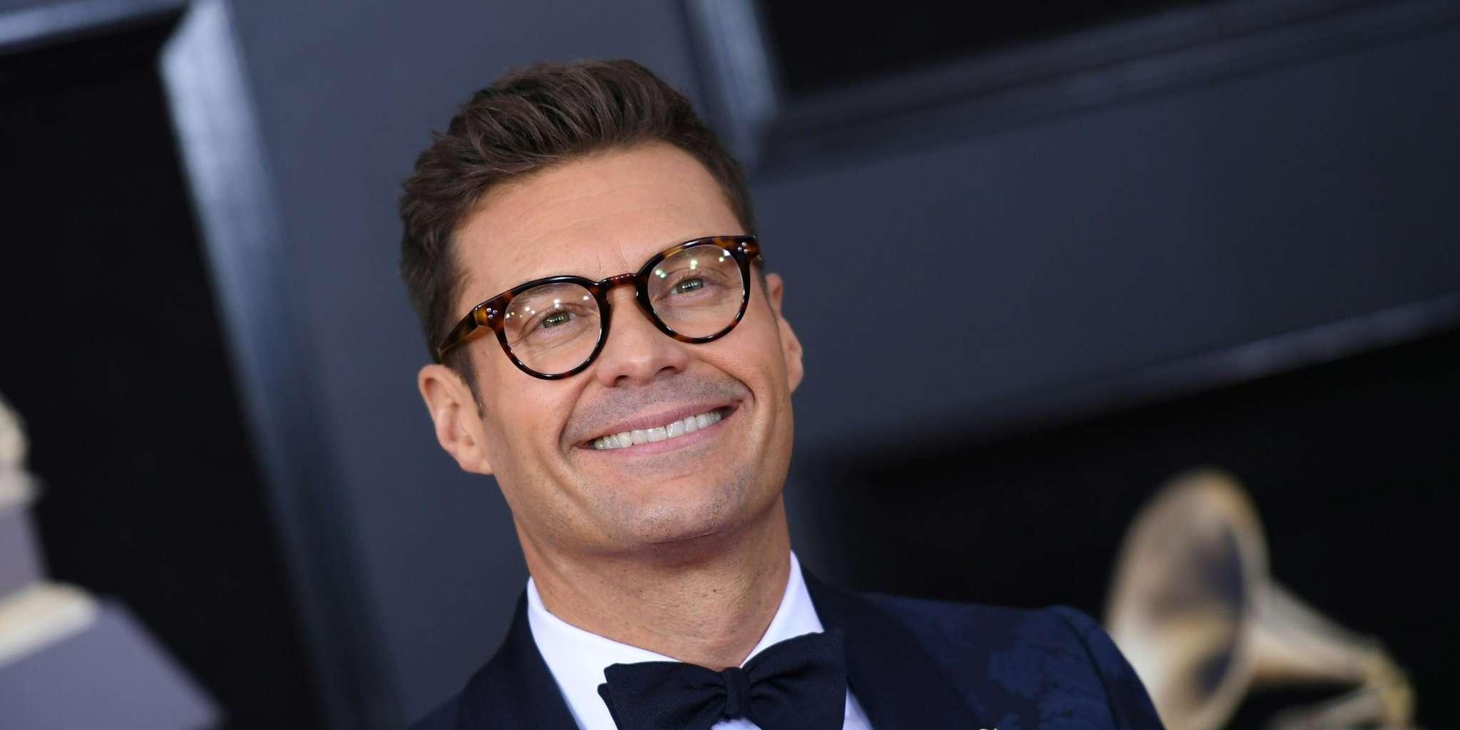 Ryan Seacrest Takes A Tumble On His Live Show - See Him Fall Backwards Along With His Chair!