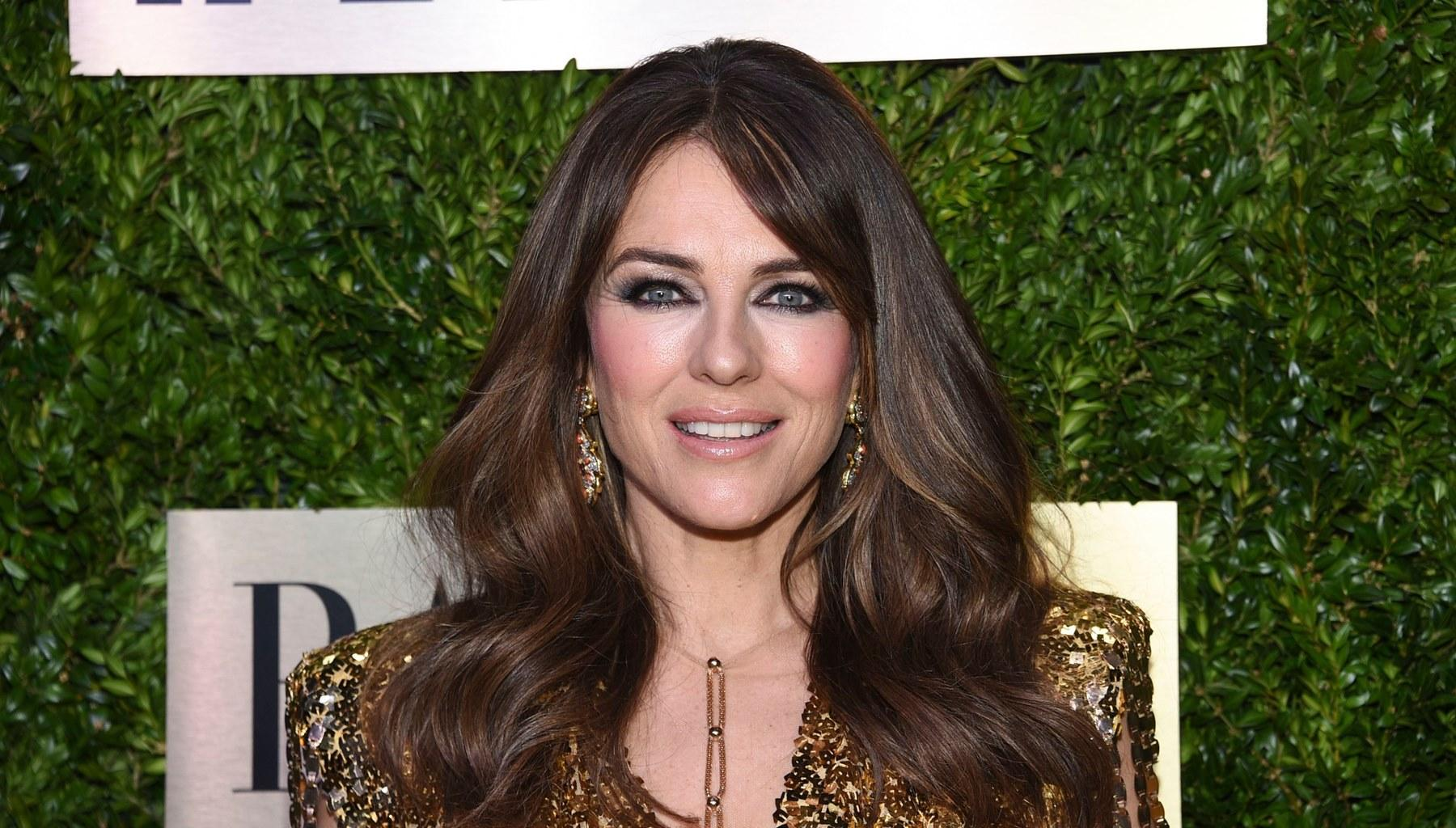 Elizabeth Hurley Is Age-Defying In A Skimpy Bathing Suit While Riding A Bike In New Video