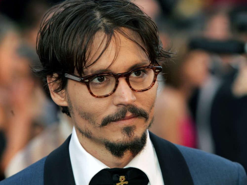 Johnny Depp Jokingly Says He'll 'Drown' And 'Burn' Amber Heard In 2013 Text Messages To Paul Bettany