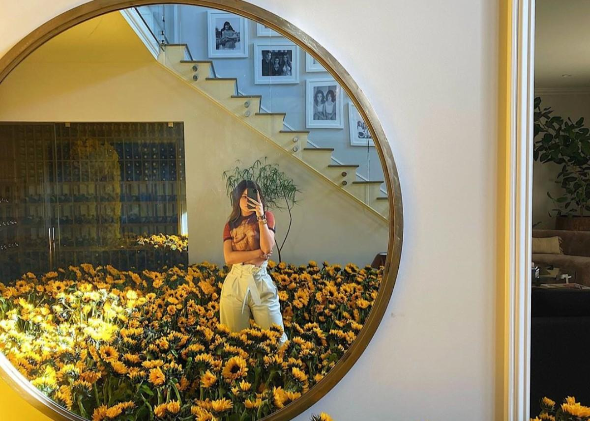 Kylie Jenner Poses In A Room Full Of Sunflowers — Did Travis Scott Give Them To Her?