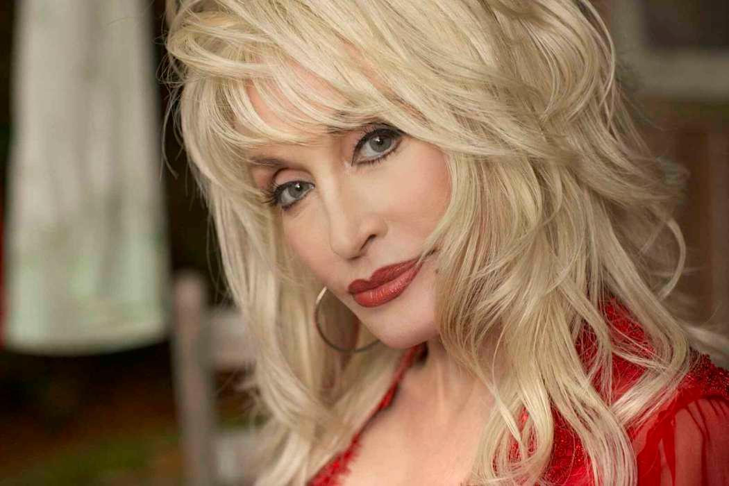 Dolly Parton Mourns The Death Of Kenny Rogers