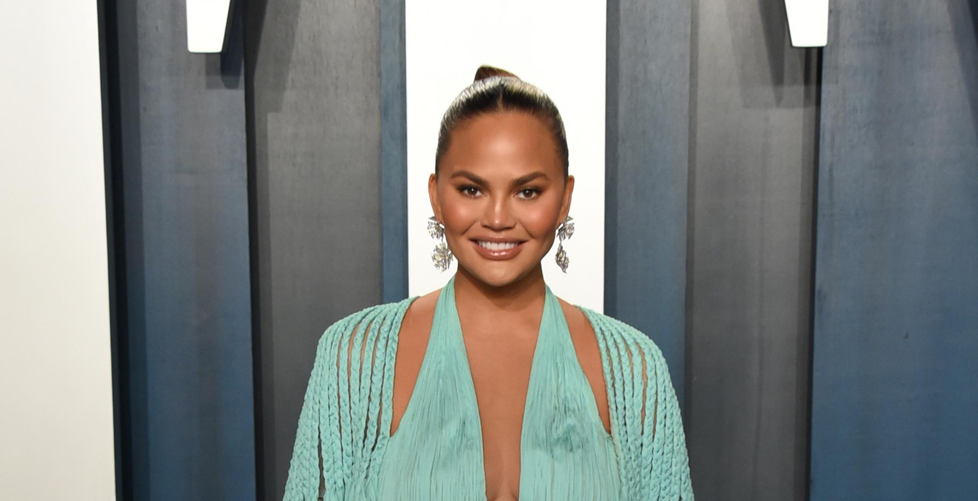 Chrissy Teigen Body-Shamed After Sharing Thirst Trap Vid Of Her In A Plunging Bathing Suit - She Claps Back!