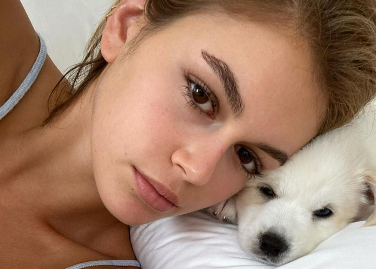 Kaia Gerber Wears A Two-Piece Bathing Suit And Snuggles Two Cuddly Puppies As She's Photographed Without Her Cast