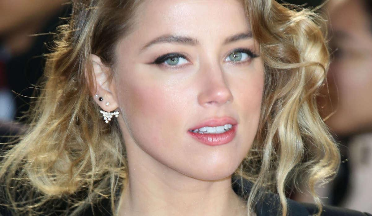Amber Heard Says Johnny Depp Once Threw 30 Bottles At Her Head In 2015