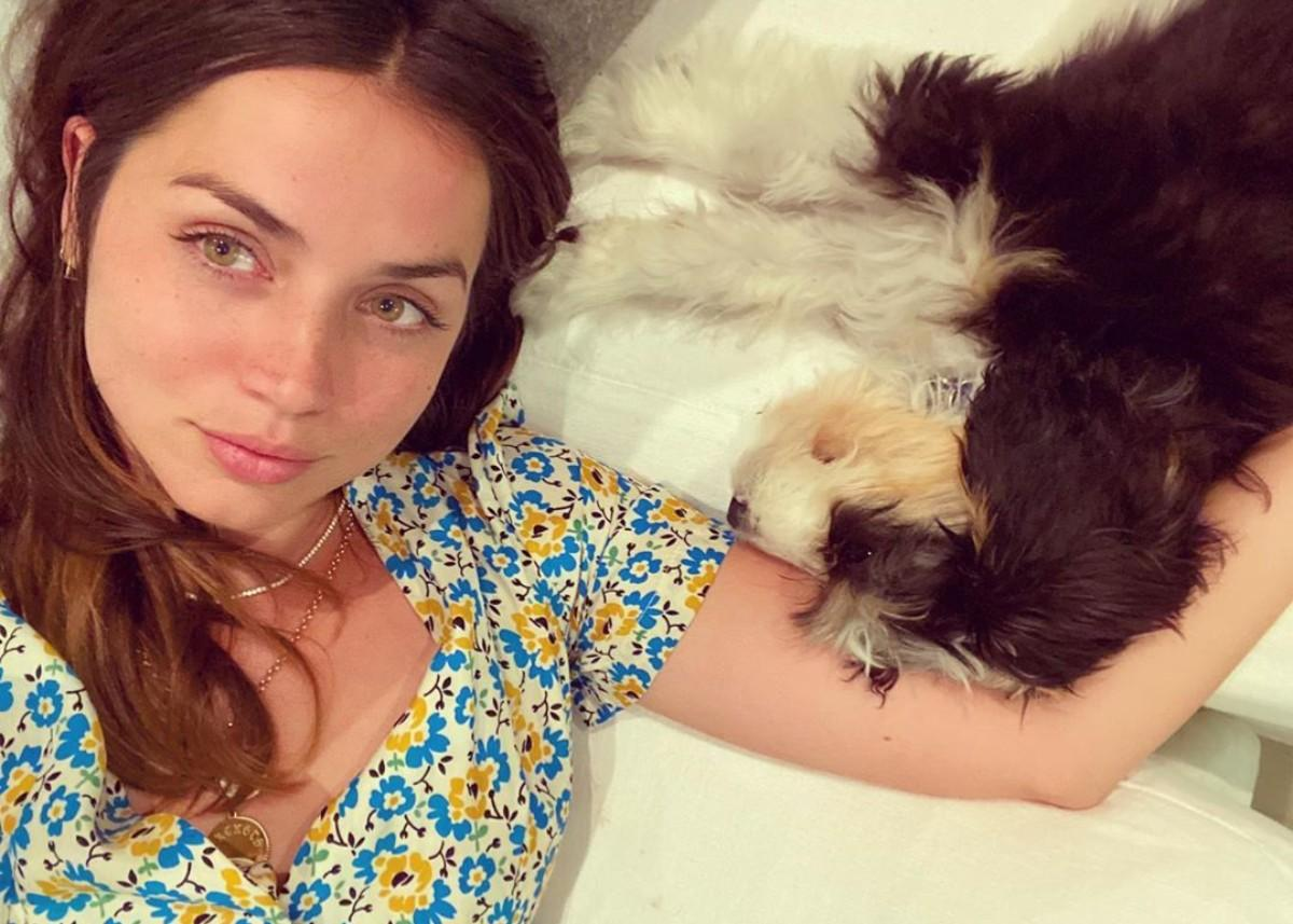 Ana De Armas Wears Floral Print HVN Dress As She Snuggles With Her Puppy
