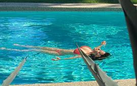 Salma Hayek Shared An Instagram Photo Of Her Rocking A Deep Red Bathing Suit At The Edge Of Her Pool