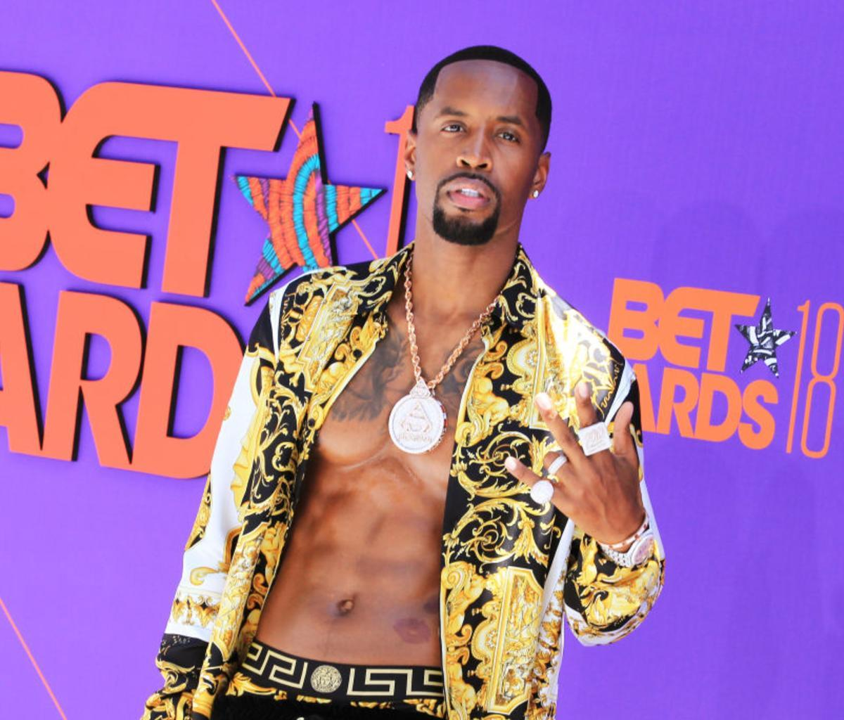 Safaree Poses With His And Erica Mena's Baby Girl In His Arms - Check Out The Gorgeous Photo In Their Amazing Home