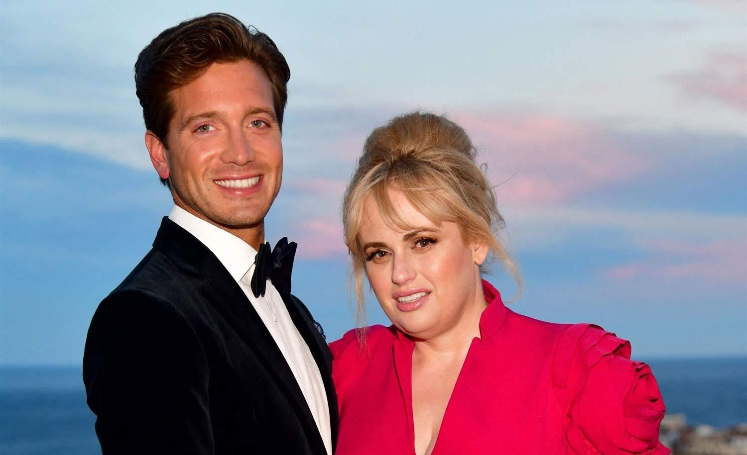 Rebel Wilson And Her BF Jacob Busch Pack The PDA In Cute Beach Video - Check Out Her Stunning Strapless Bathing Suit!