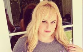 Rebel Wilson Works Out With A Bottle Of Vodka While Wearing Gucci