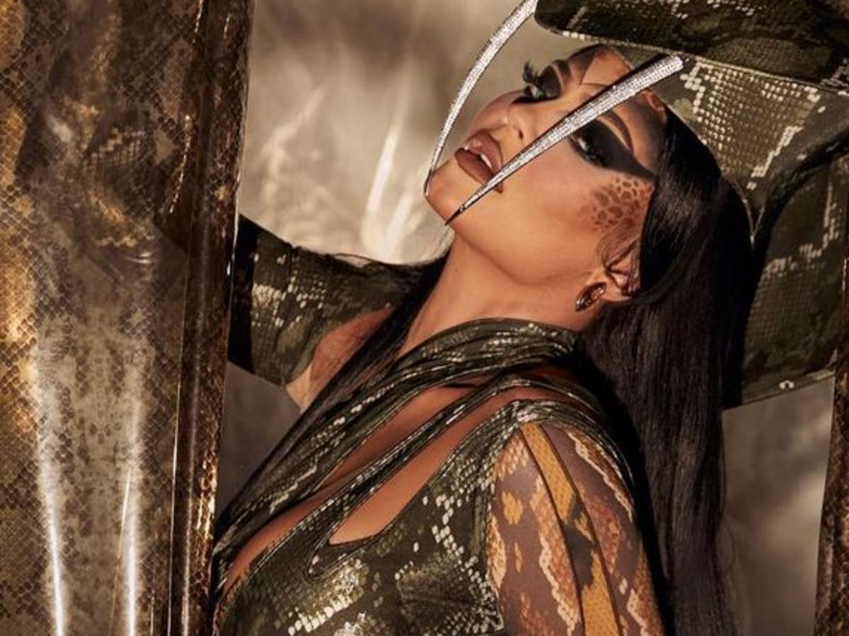 Kylie Jenner Dresses In Curve-Hugging Snake Skin Outfit For Kendall Jenner's Halloween/Birthday Party