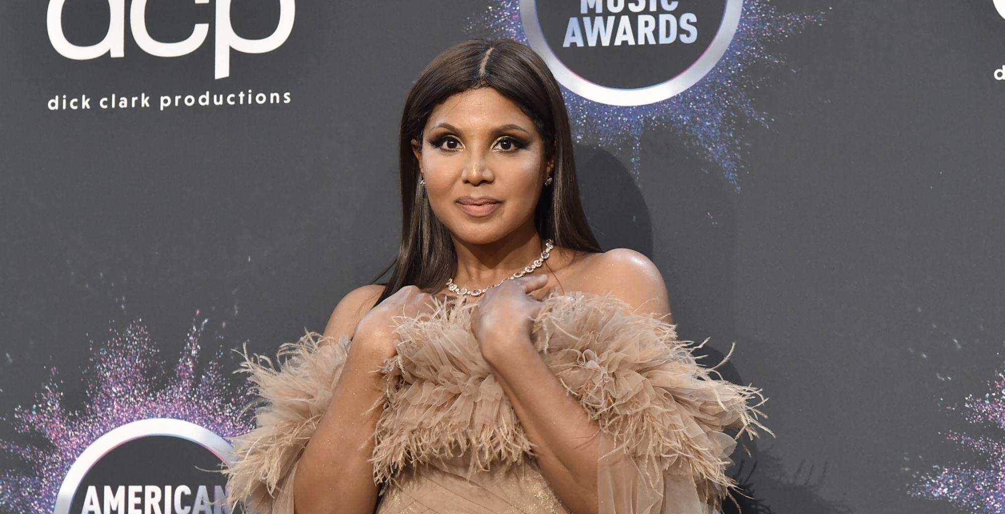 Toni Braxton Has Fans Drooling With This Photo - Check Out Her Red Revealing Dress!