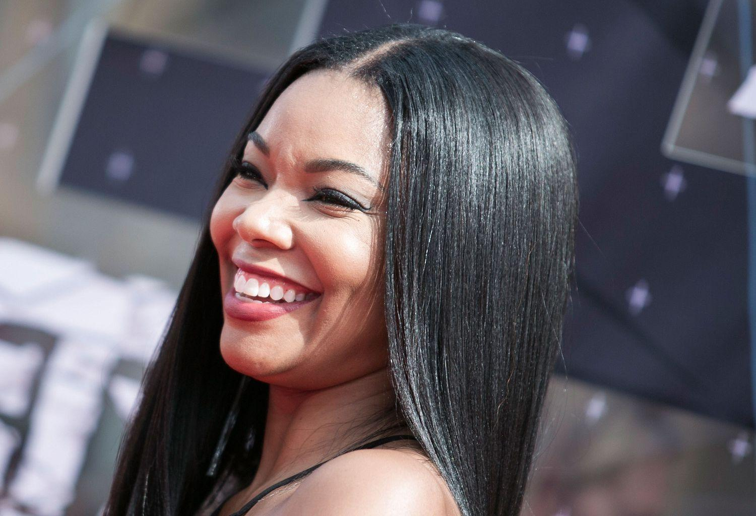 Gabrielle Union Shows Off Her Flawless Body In A Yellow Swimsuit For Christmas