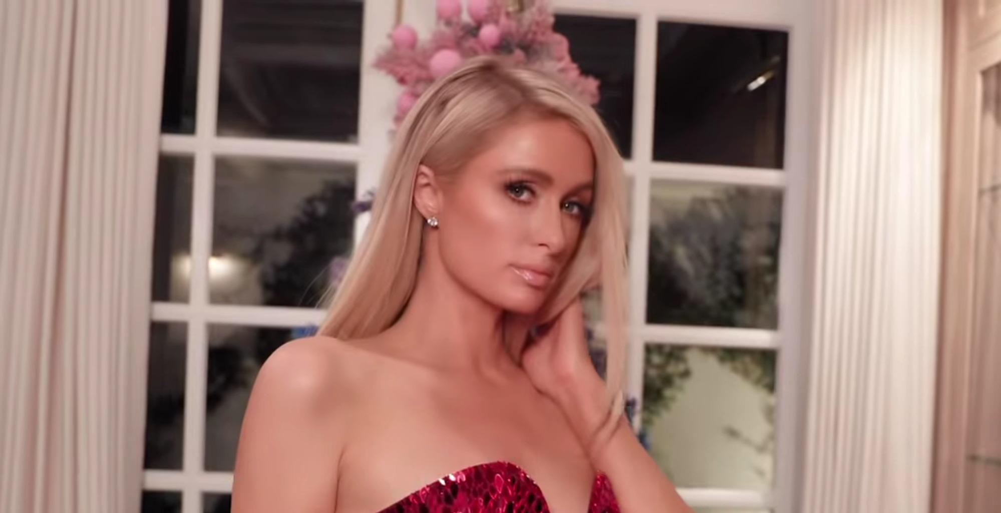 Paris Hilton Shows Off Her Favorite Holiday Looks In A Fashion Show Video