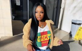 Reginae Carter Wishes A Happy Birthday To Robert Rushing, And All Fans See Is Her Bold Look In The Family Photo