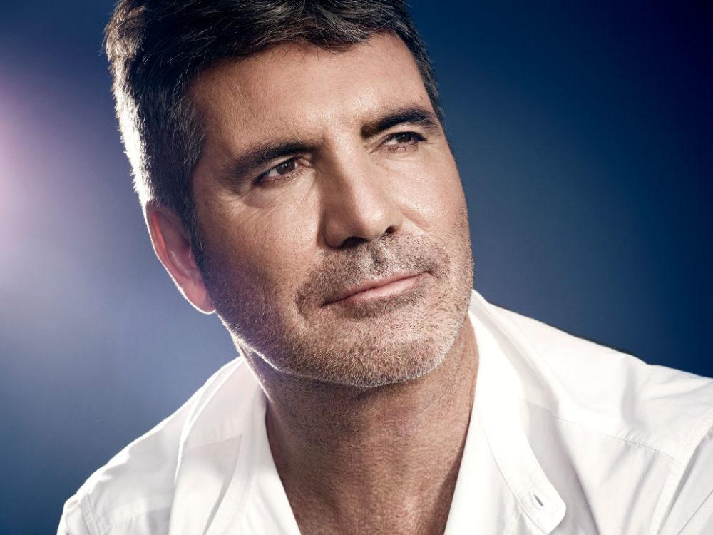 Simon Cowell Puts An End To 2020 With A Large Scar On His Back Following E-Bike Injury