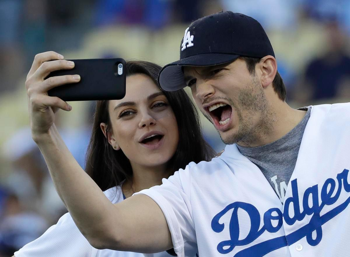 Mila Kunis Jokes That She And Ashton Kutcher Did This Super Bowl Commercial To Get A Break From Their Two Kids!