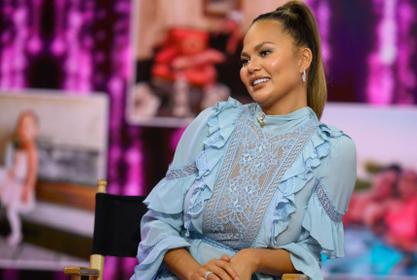 Chrissy Teigen Shows Off Her Hooters Uniform