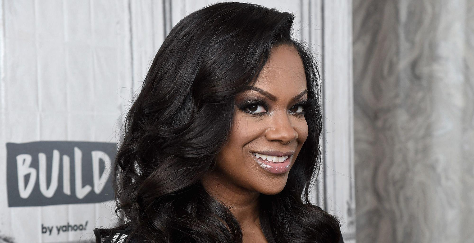 Kandi Burruss Flaunts A Gorgeous Cleavage In This Video - Check It Out Here
