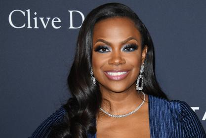 Kandi Burruss Shows Off Her Toned Legs In This Mini Dress For Her BFFs Anniversary