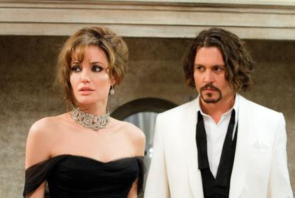 Johnny Depp Shooting His Shot With Angelina Jolie? - He's Reportedly Crushing Hard And Trying To 'Woo' Her!