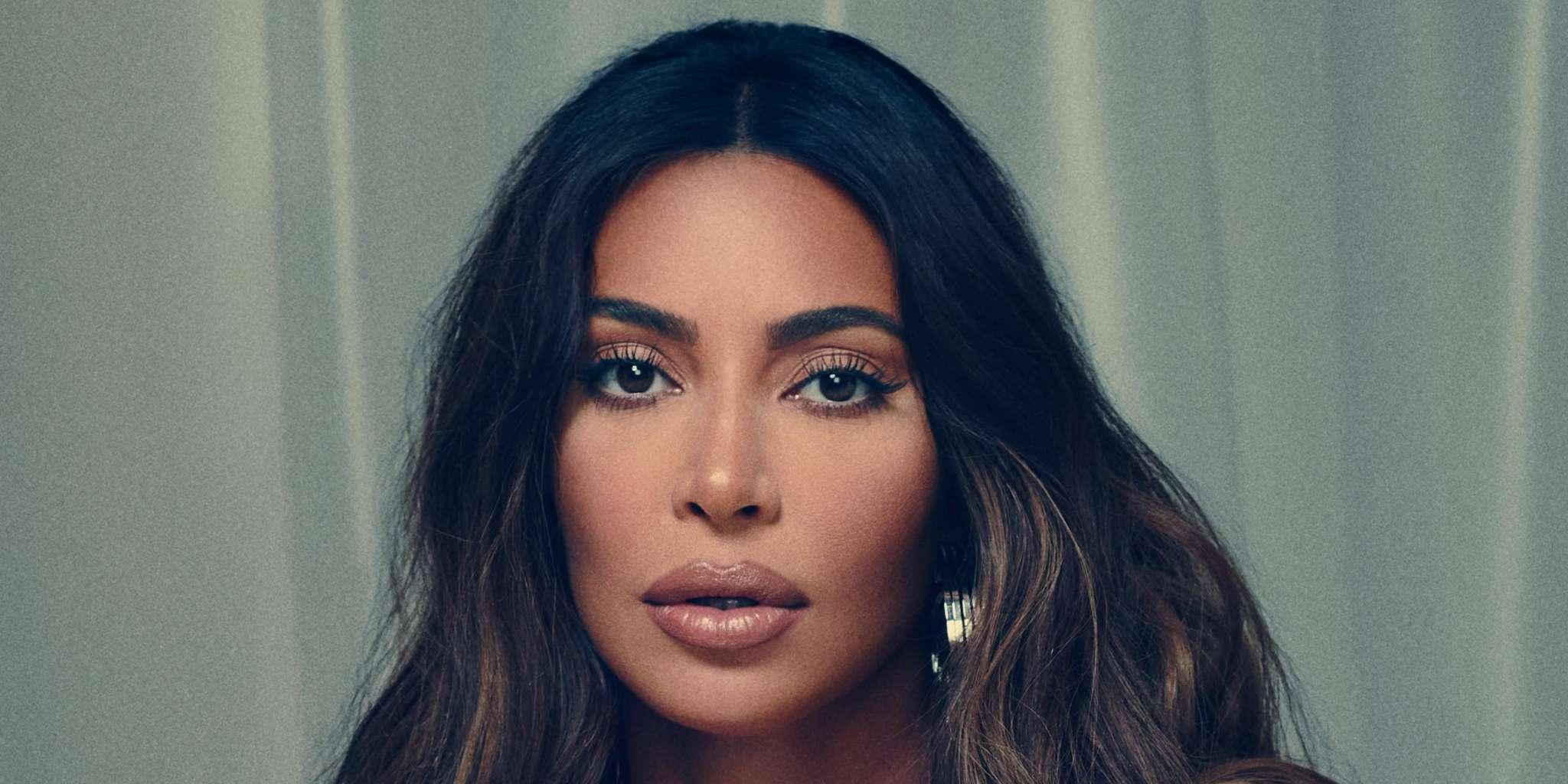 KUWTK: Kim Kardashian Almost Bares It All While Sultrily Posing In Bed With Nothing But A Sheet Covering Her