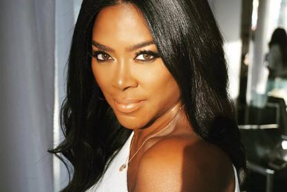 Kenya Moore Teaches Fans How To Stretch Preventing Injury
